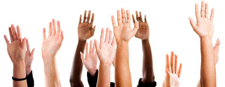 Group of hands raised in the air